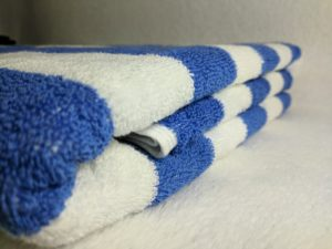 Nortex blue and white striped hospitality pool towel front view image